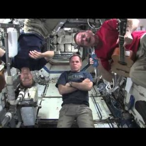 Peter talks with the crew members of Expedition 34